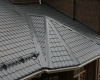Сколько стоит покрыть крышу металлочерепицей?