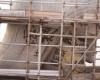 Бразильские рабочие ремонтируют поврежденного молнией Христа